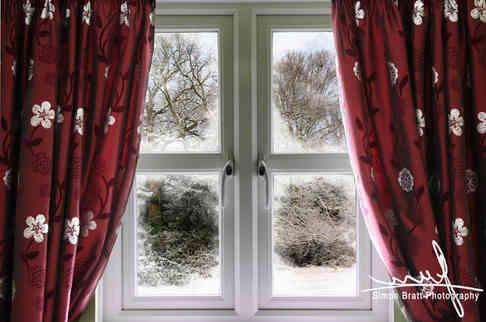 Dressed UPVC window in winter