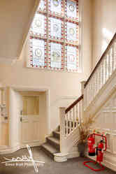 Impressive entrance hall and stainglass