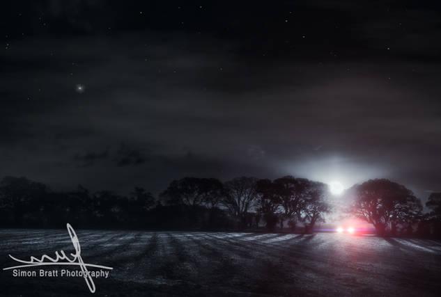 Lone Driver In A Dark Field
