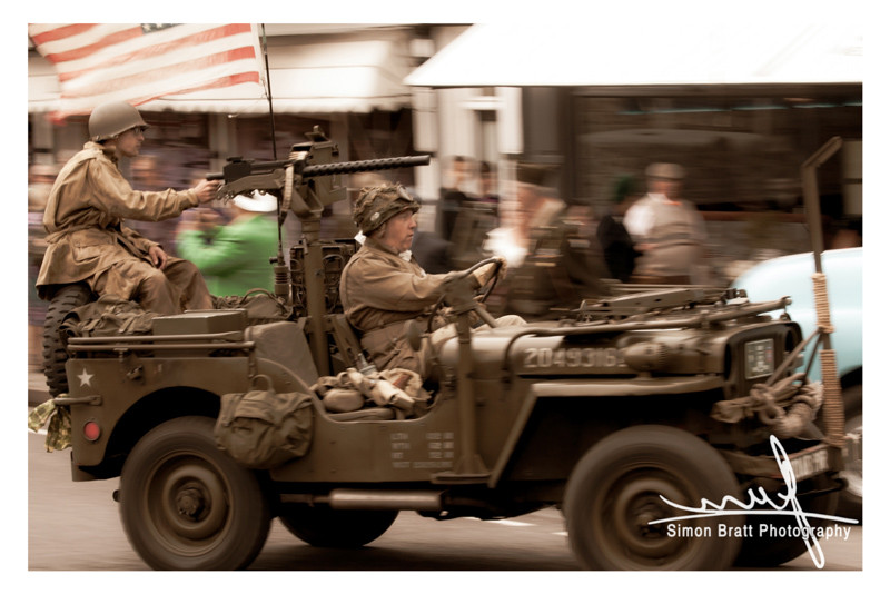 Works War II reenactment vehicle and soldiers