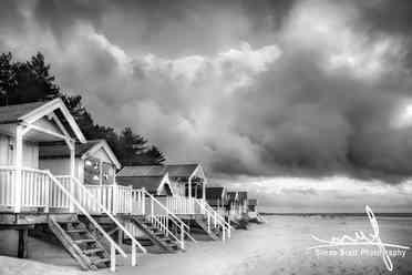 Mono beach huts in storm