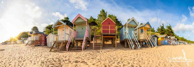 Colourful beach huts sunrise panoramic view
