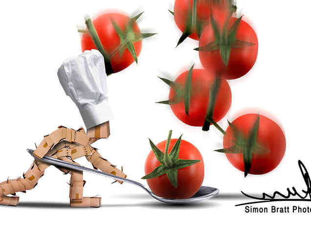 Box character chef catching tomatoes