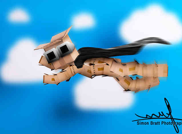 Box character hero flying in clouds