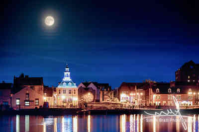 Historic town skyline with supermoon