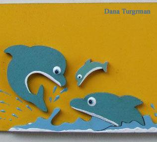 שלט עם משפחת דולפינים