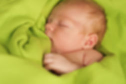 Newborn baby Sleeping  on a green blanke