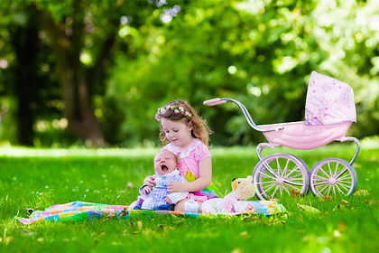 Family with children enjoying picnic out