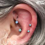 Fresh helix piercings with mint Swarovski Zirconia and healed conch with capri blue opal