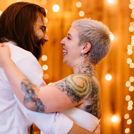 Angela and Evan, featuring white opal and tanzanite plugs