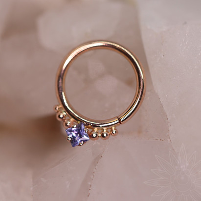 Rose gold and princess cut Tanzanite with gold beaded accent