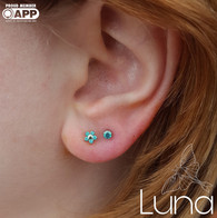 Mint green Swarovski Zirconia in a first and second fresh earlobe