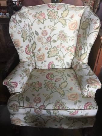 Wingback parlor chair with floral zipoff