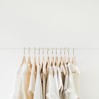 Canva - White Clothes Hanging on Rack.jp