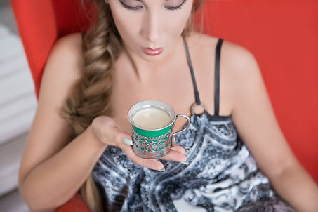 Arina drinking a fresh cup of Bay Chai in Krasnoyarsk, Russia