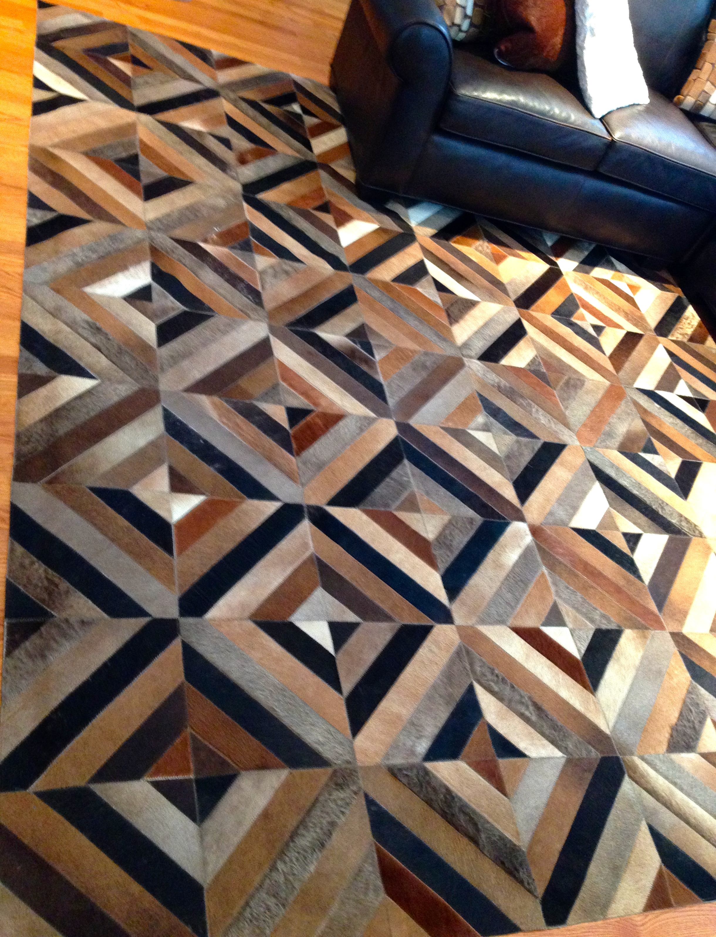 Urquiza cowhide patchwork rug