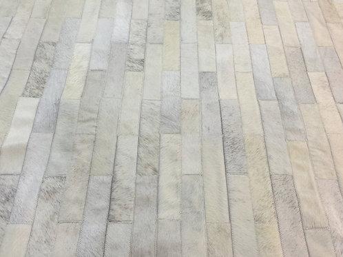 Retiro cowhide patchwork rug