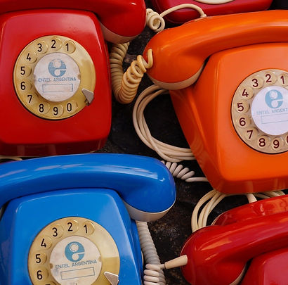 seven-assorted-colored-rotary-telephones