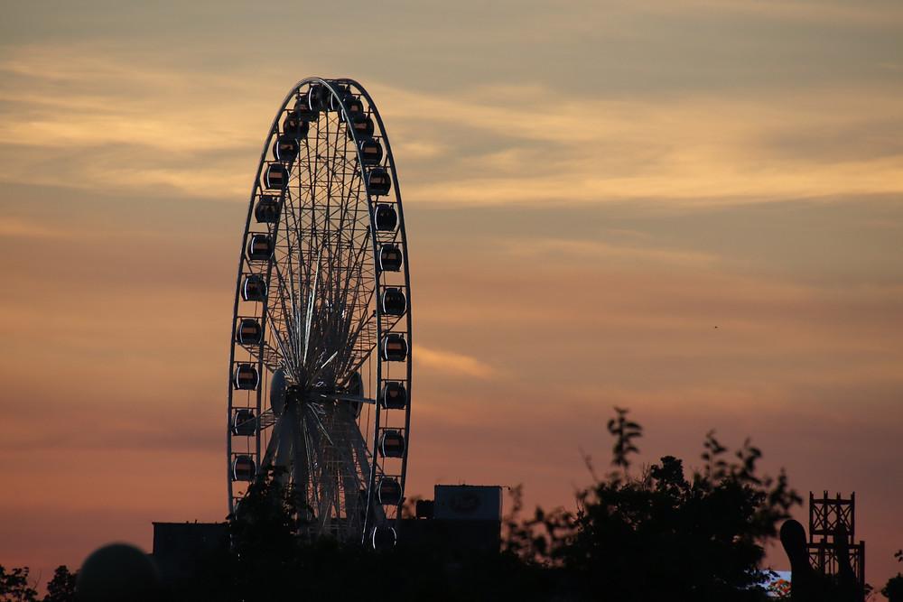 Ferris Wheel Framed in A Sunset