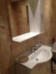 a bathroom sink and bath in bathroom fitted by Heatwave heating and plumbing