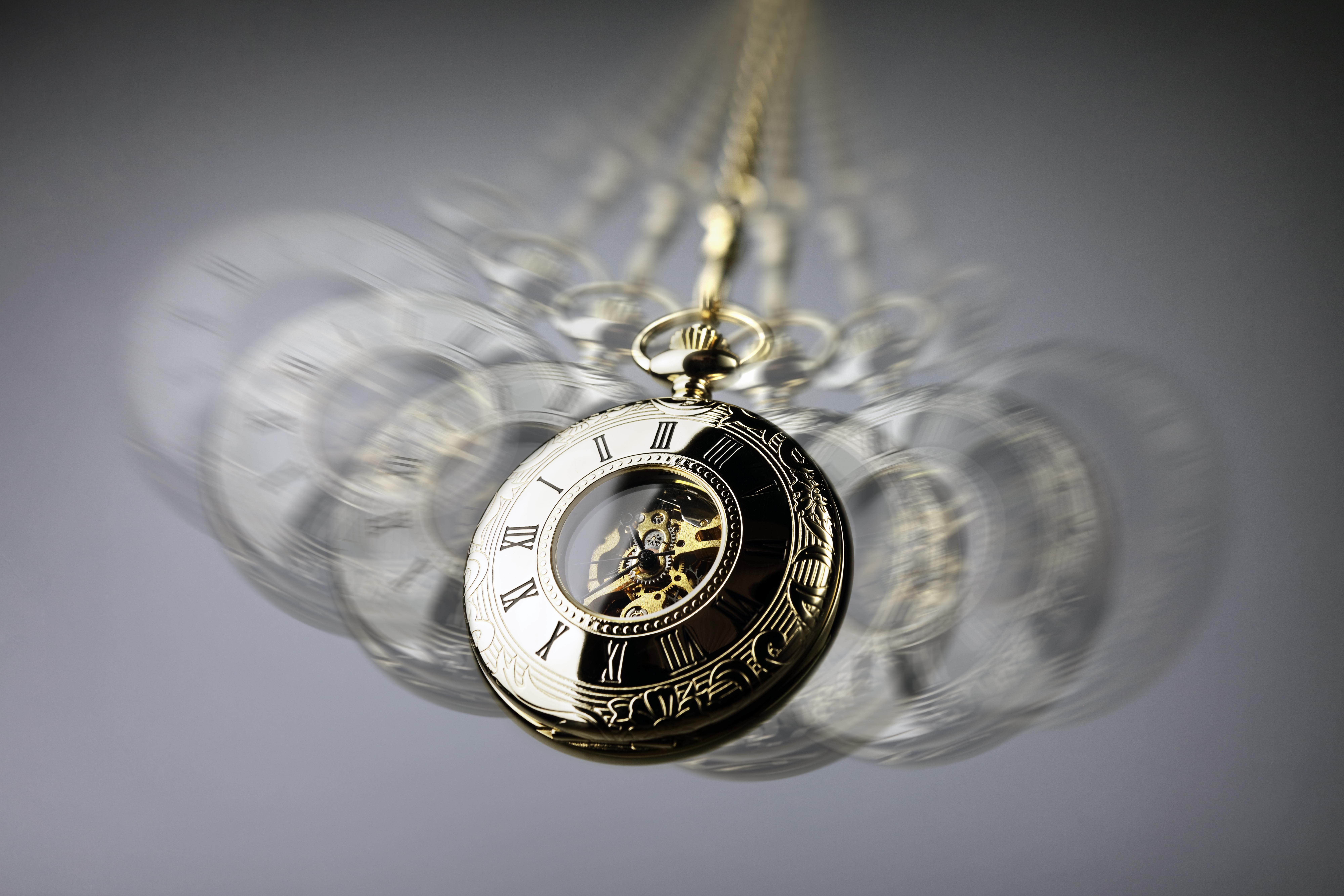 Hypnotism concept, gold pocket watch swi