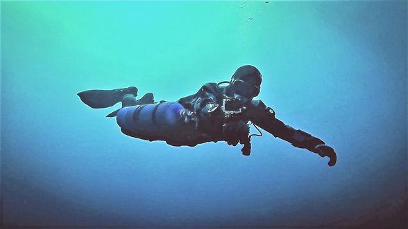 Diver Instructor using a Camera