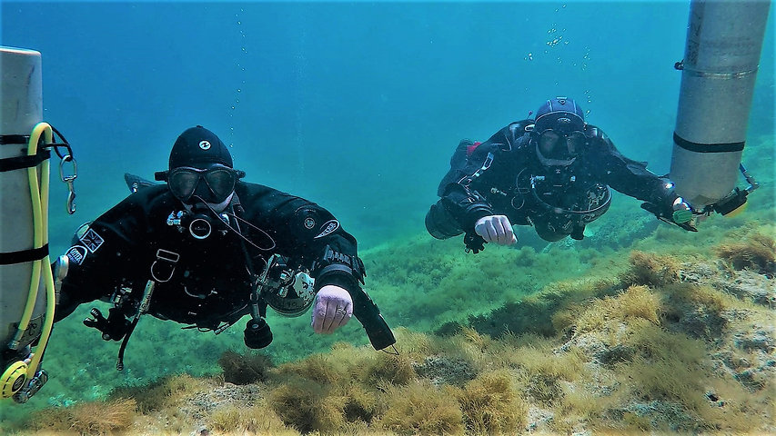 Technical divers making a shore exit