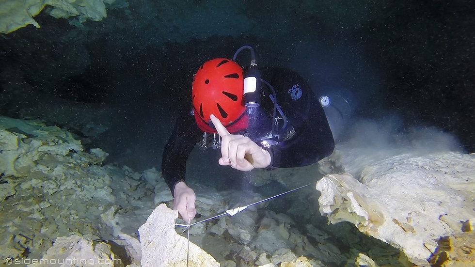 Cave diver making navigation decisions