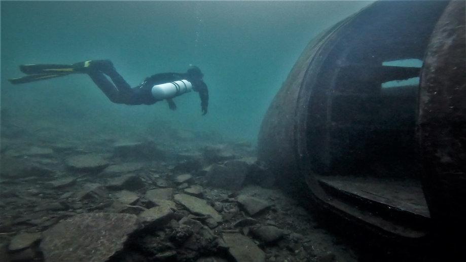 Sidemount Diver examinng an aeroplane fuselage at Stoney Cove, UK