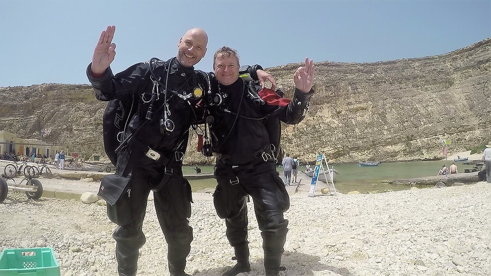 Technical divers giving a big OK after completing a PADI Tec 50 course