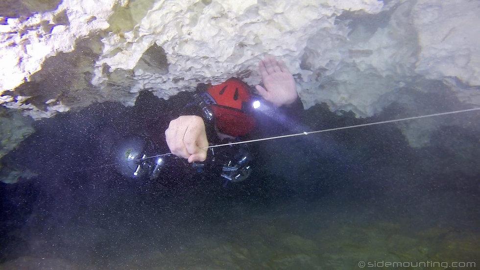 Cave Diver making a zero visibility cave exit