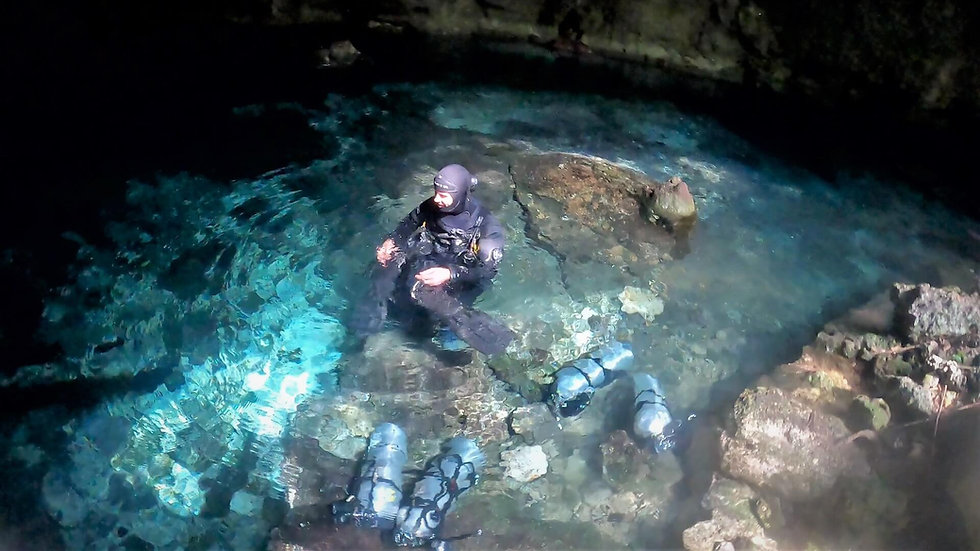 Cave Diver gearing up in a Cenote before a cave dive