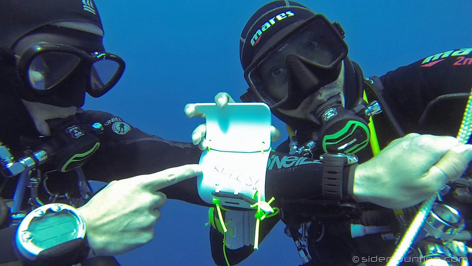 Technical divers reviewing the dive plan