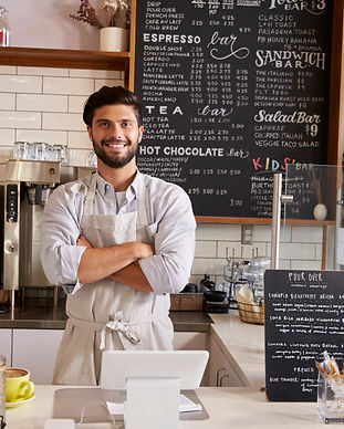business-owner-at-the-counter-of-coffee-