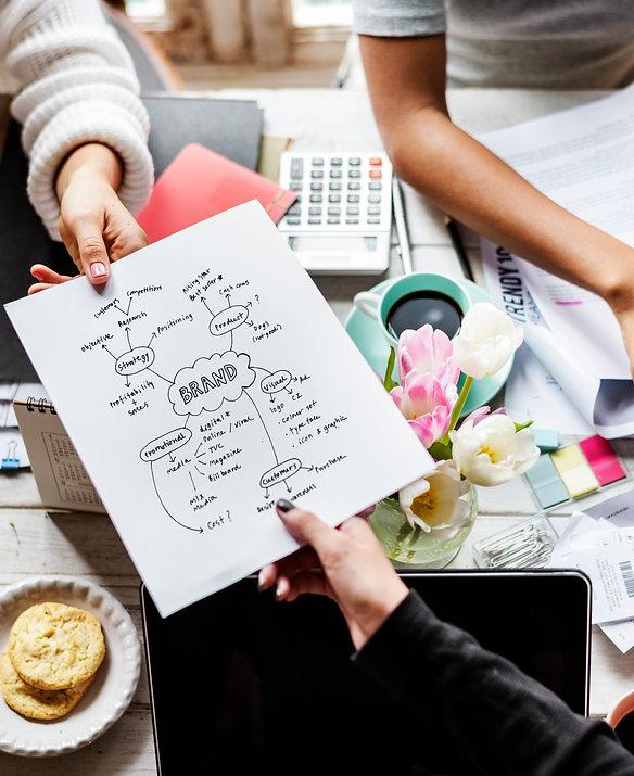 colleagues-handing-branding-plan-strateg