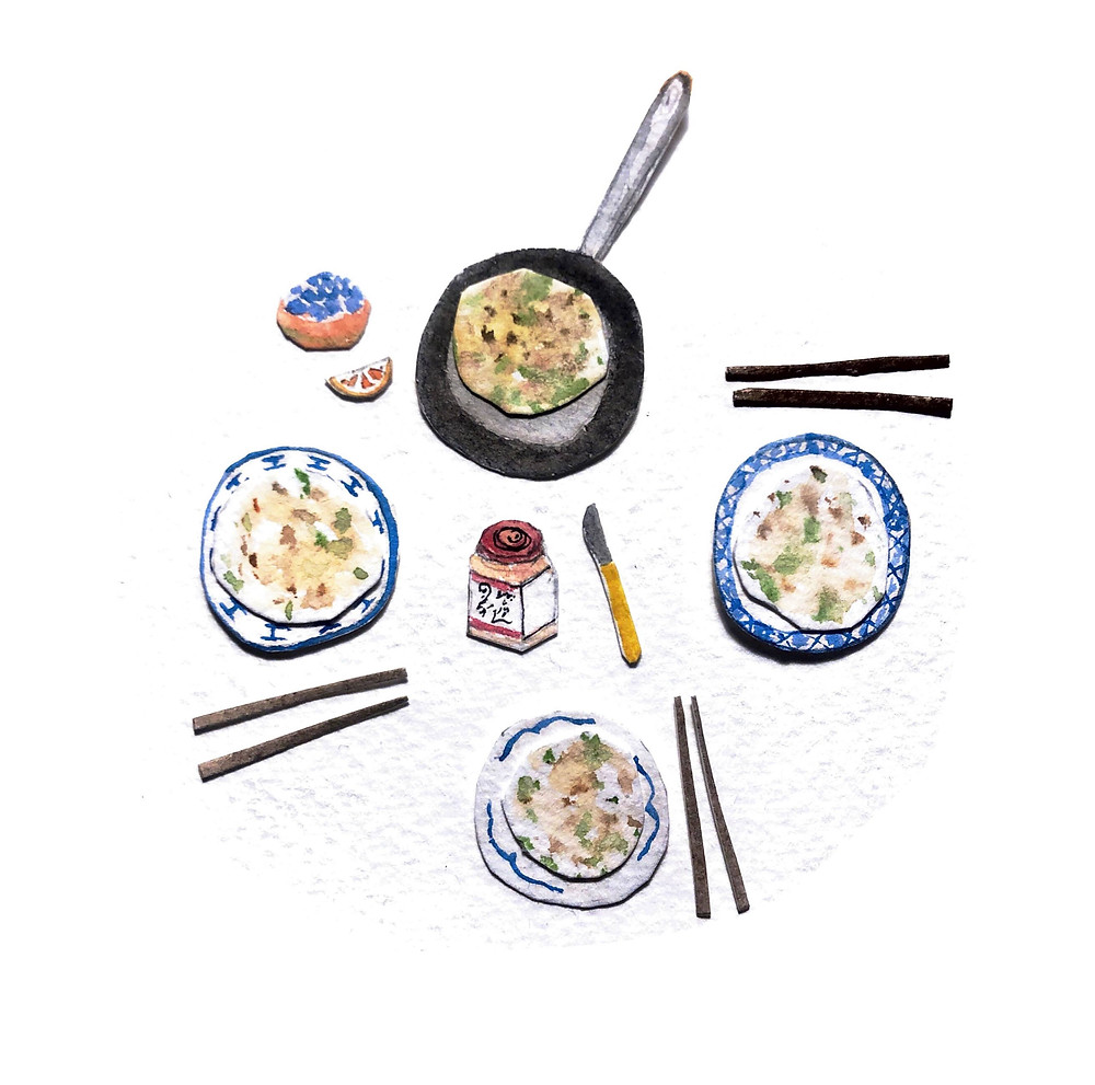 A cut out watercolour illustration of a table layout with chopsticks, a pan, some toppings and plates with spring onion pancakes on them