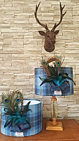 One-off handmade wool and fabric lampshades fnisnhed with tweed and feathers