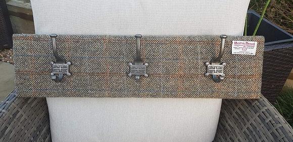 Handmade Harris tweed rust and brown herringbone with an overcheckcoat hanger