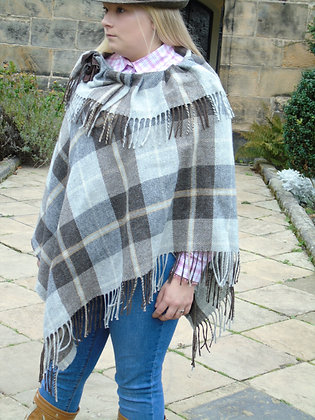 A one-off handmade poncho made from 100% brown and grey wool