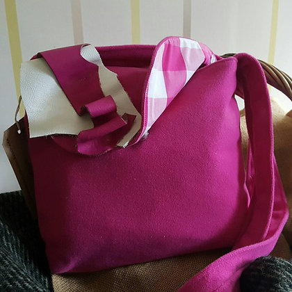 A one-off handmade 100% wool hand bag. Fully lined with pocket and leather trim