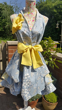 Wrapped and rouched sky blue dress with lemon flowers and dragonfly. Lemon sash