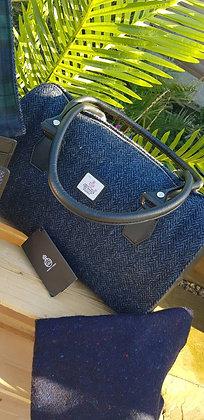 Maccessori bowling bag made from Harris Tweed navy herringbone wool.