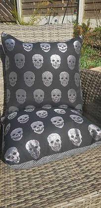 Handmade black and shiny silver skull cushions
