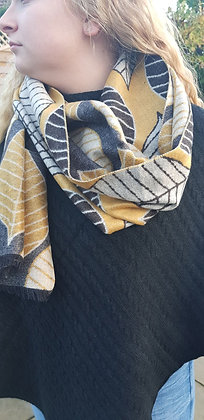A supersoft mustard grey and black leaf print scarf. Reversible