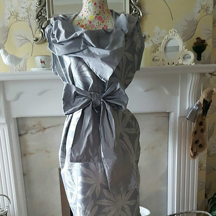 A one off handmade grey silk hitched dress, made from grey leaf design silk fabr