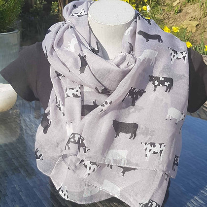 Black and white small print cows on a grey lightweight fashion scarf