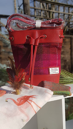 SnowPaw bucket bag made from Harris Tweed, pink with red faux leather