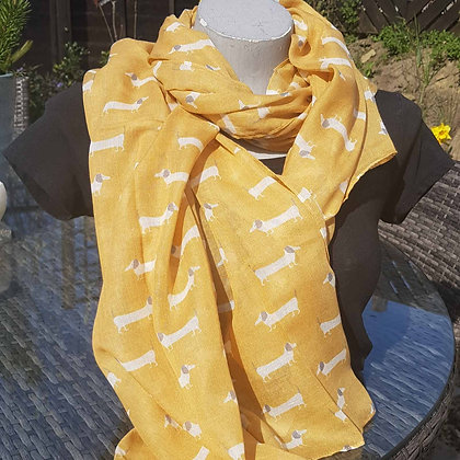 Cream and grey daschund dogs on a mustard lightweight fashion scarf.