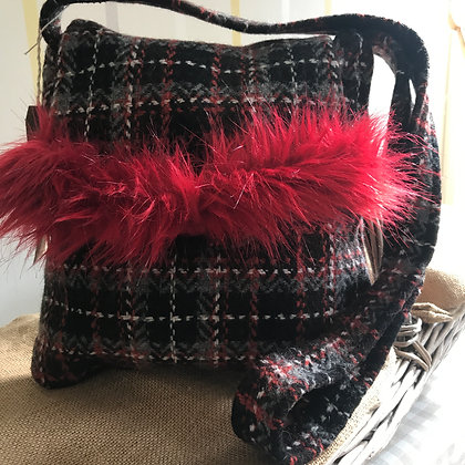 One-off handmade 100% wool hand bag. Fully lined with pocket and leather trim