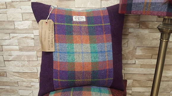 A one-off handmadecushion made from chunky wool with a large Harris tweed panel